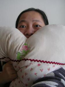 writer with a pillow